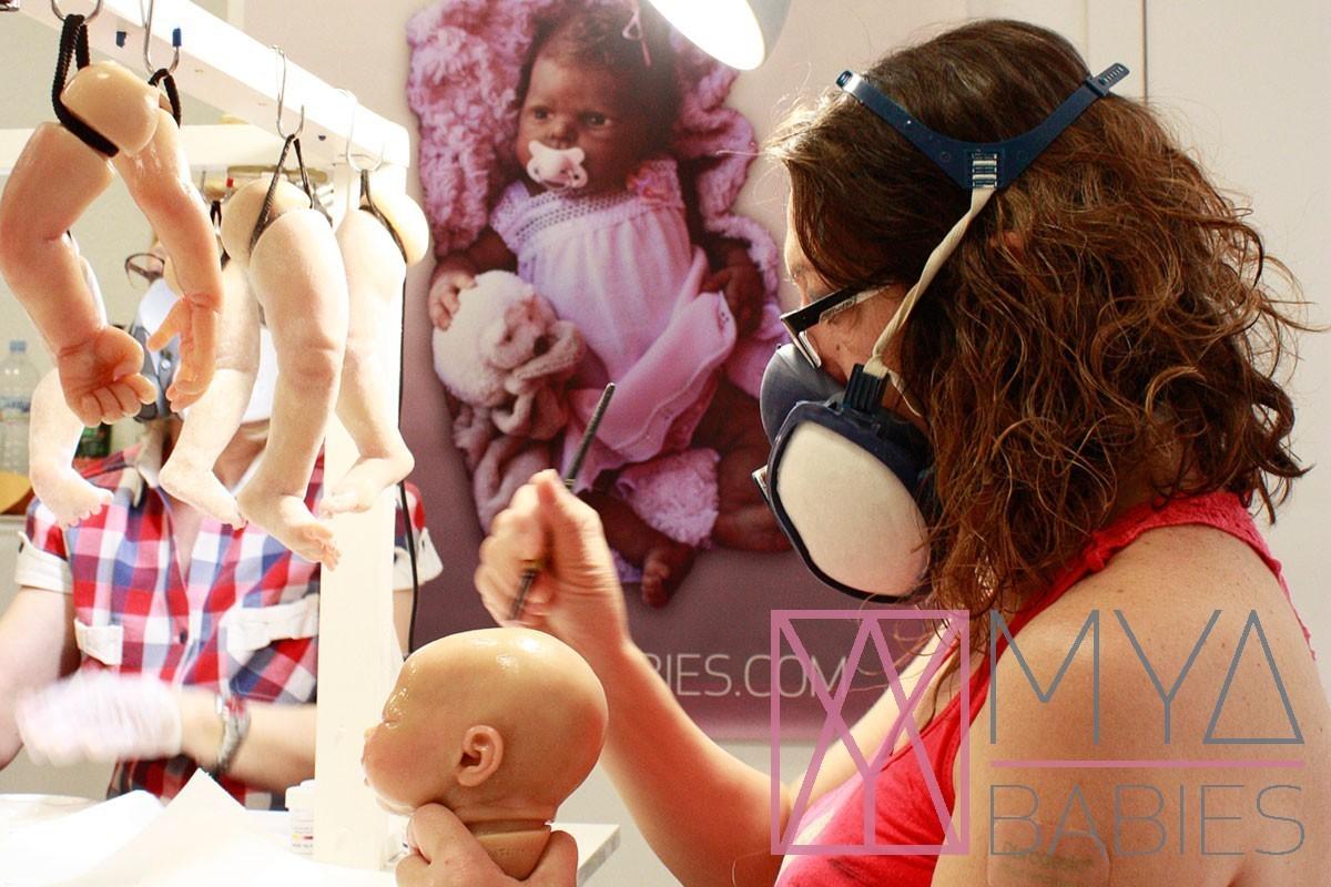 Reborn artist using respirator